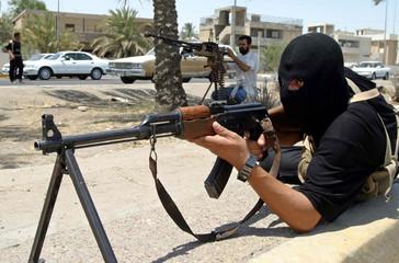 Iraqi Shi'ite militiamen control street in southern city of Basra.
