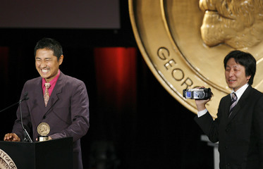 "Director Soda is filmed by a friend as he accepts his Peabody for the film ""POV: Campaign"" in New York"