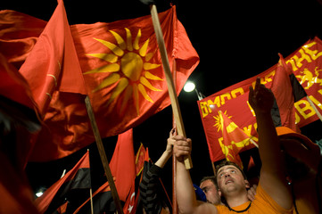 Supporters of the biggest ruling party VMRO wave flags during the first election rally in Ohrid