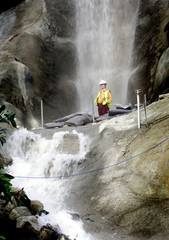 - PHOTO TAKEN 19FEB01 - A staff member stands beneath a giant waterfall in one of the Biomes at the ..