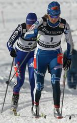 Finland's Kuitunen speeds up in front of Switzerland's Mischol during the women's 1.2 kilometres ...
