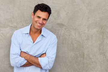 handsome mature man standing by wall Wall mural