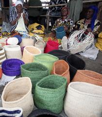 Women weave baskets at the open-air Ngara market near the capital Nairobi