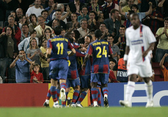 Barcelona's players celebrates Lionel Messi's goal against Olympique Lyon during the Champions League Group E soccer match at Nou Camp stadium in Barcelona
