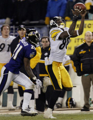 STEELERS PLAXICO BURRESS MAKES PASS RECEPTION IN FOURTH QUARTER.