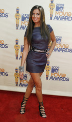 Actress Ashley Tisdale poses at the 2009 MTV Movie Awards in Los Angeles