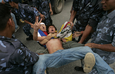 Police arrest Tibetan protesters near the Chinese embassy in Kathmandu