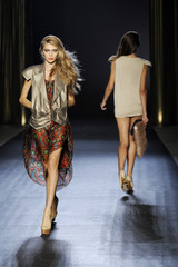 Models present creations by Russian designer Alena Akhmadullina as part of her Spring/Summer 2010 women's collection during Paris Fashion Week