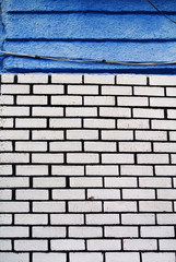 white brick wall and blue