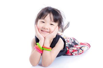 Little asian girl lying on floor over white background