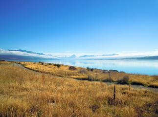 Mount Cook reflecting in Lake Pukaki, New Zealand - Stock Photo
