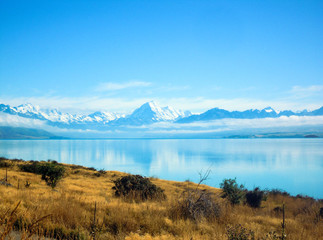 Mount Cook reflecting in Lake Pukaki, New Zealand - Stock Photo