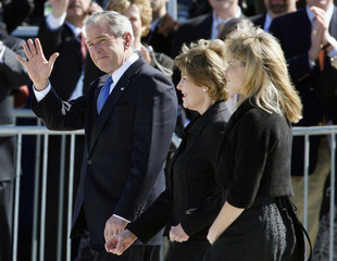 U.S. President George W. Bush acknowledges the crowd as he walks out with first lady Laura Bush and daughter Jenna Bush to greet Pope Benedict  XVI at Andrews Air Force Base in Maryland