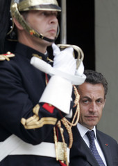 France's President Sarkozy awaits Armenia's President Kocharyan before their meeting at the Elysee Palace in Paris