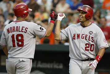 Angels Kendry Morales is greeted by teammate Juan Rivera after hitting a two run home run against the Orioles in Baltimore