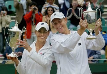 BLACK OF ZIMBABWE AND STUBBS OF AUSTRALIA HOLD UP THEIR TROPHIES AFTER DEFEATING HUBER OF SOUTH AFRICA ...