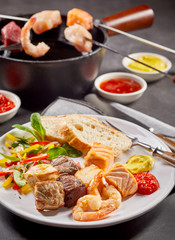 Surf and turf seafood and meat fondue
