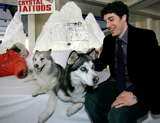 Jason Biggs pets DJ at the party for the premiere of Eight Below in Hollywood