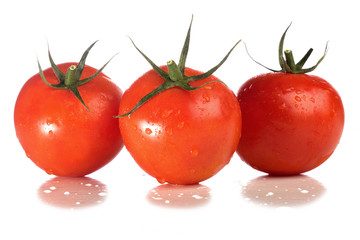 Picture of red tomatos solated against white background