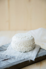 Fresh Cottage Cheese On Wooden Background, Close Up