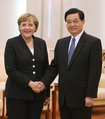 German Chancellor Angela Merkel shakes hands with Chinese President Hu Jintao in Beijing