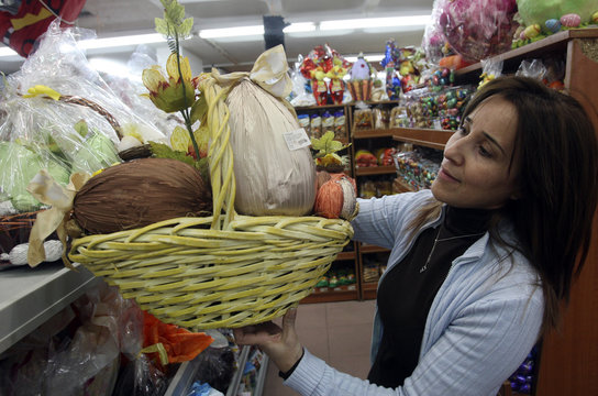 A woman selectes an Easter egg craft from a sweet shop in Beirut