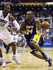 Los Angeles Lakers Kobe Bryant drives to the basket on Orlando Magic Dwight Howard during the second quarter of Game 3 of their NBA Finals basketball game
