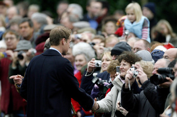 Britain's Prince William talks to well-wishers as he leaves St Mary Magdalene's church after the Royal Family's Christmas Day service on the Sandringham estate in eastern England