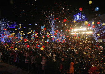 People release balloons during a New Year's Eve countdown party in Beijing