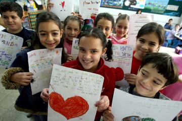 Students display drawings for Israeli Prime Minister Ariel Sharon in Jerusalem