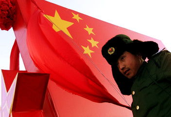 A SOLDIER WATCHES OVER AN ARMY LATERN DISPLAY FEATURING THE CHINESE FLAG IN XILINHOT IN INNER MONGOLIA.