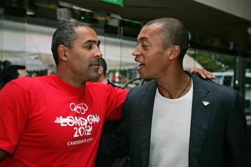British decathlete Thompson talks to French athlete Diagana in Singapore.