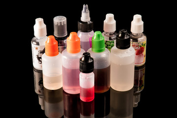 10 E-juice bottles on a black backdrop