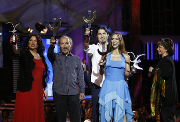 Chilean singer Silva and her group hold their Silver Seagull trophies in Vina Del Mar