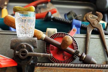 Glass of vodka on Locksmith's vise.