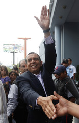"""Honduran President-elect Porfirio """"Pepe"""" Lobo waves to supporters as he leaves a local television station in Tegucigalpa"""