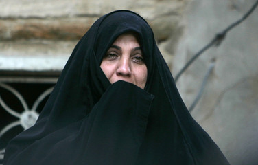 A woman cries at the scene a mortar attack in Baghdad