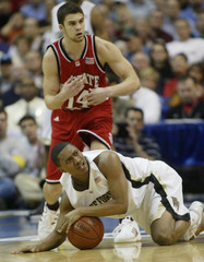 Justin Gray of Wake Forest falls to the floor in front of Engin Atsur of NC State.