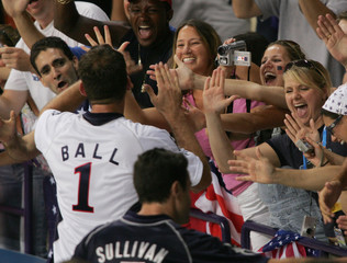 Lloy Ball and Erik Sullivan of the US celebrate with supporters in the crowd after their win at the ...