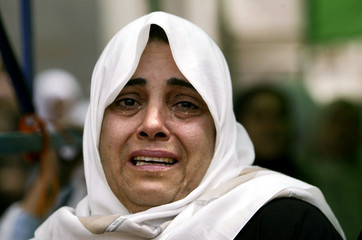A Palestinian woman relative of waleed Ashour, 22, cries as his body brought home during his funeral..