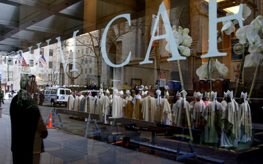 Bishops and priests are reflected as they arrive at the Saint Patrick's Cathedral to attend a mass led by Pope Benedict XVI in New York