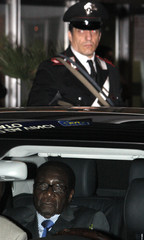 Zimbabwe's President Mugabe sits in the car after arriving at Fiumicino airport in Rome
