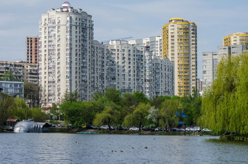 Lake and park in the city near the residential area