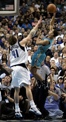 New Orleans' Pargo shoots over DallasÕ Nowitzki in their NBA play-off game in Dallas