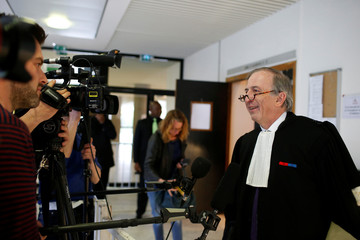 Lawyer Paul-Albert Iweins for French magazine Closer talks to journalists as he leaves the courts in Nanterre, near Paris