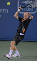 Russia's Davydenko returns a shot to Spain's Ferrer during their quarter-final match in the 2007 Cincinnati Masters tennis tournament in Cincinnati