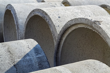 Many concrete pipes