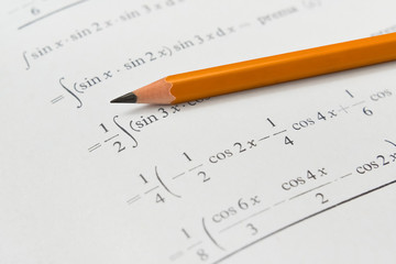 Math book and pencil