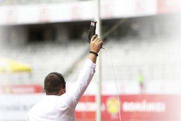 Starter.Hand firing a gun for starting race