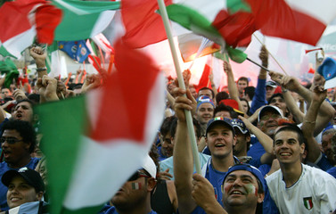 Italian fans reacts after Italy scores the teams first goal while watching the Group E World Cup 2006 soccer match between Italy and the U.S. on a public viewing spot in Kaiserslautern